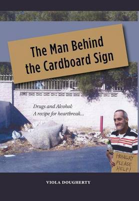 The Man Behind the Cardboard Sign